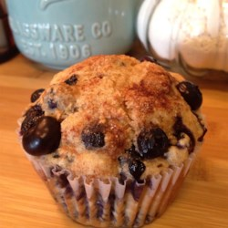 Jumbo Whole Wheat Blueberry Muffins Recipe - Make 6 filling, nutty whole wheat blueberry muffins in a jumbo muffin tin, or make a dozen regular-size muffins. Either way you'll have a hearty and filling breakfast you can bring along or enjoy with coffee.