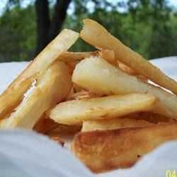 Yuca French Fries Recipe - Like French fries? Then you will love this Latino version of an American favorite! Treat yuca just like you treat potatoes. Yuca can also be used to make a scrumptious alternative to home fries for breakfast.