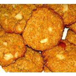 Sue's Oatmeal Macadamia Nut Cookies Recipe - This is an old family recipe that I 'tweaked' by adding macadamia nuts.  I bake about 1,000 of these every year for our St Joseph Garden Tour and I don't even have any crumbs left.