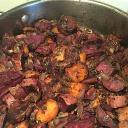 Vegetarian Purple Potatoes with Onions and Mushrooms Recipe - Purple potatoes, mushrooms, and red onions make a tasty, easy dish with an interesting purple color to jazz up your meal.