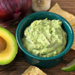 Avocado-Spinach Dip Recipe - Sour cream gives this guacamole-inspired avocado and spinach dip an extra level of creaminess.