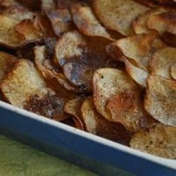 Lancashire Hot Pot Recipe - Very simple lamb and potato casserole made with layers of sliced potatoes, browned onion and leg of lamb, fresh thyme, stock and seasoning.