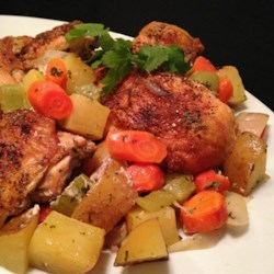 Mom's Chicken En Cocotte Recipe - Chicken pieces are browned, then simmered with carrots, potatoes, and celery in a tasty oven-braised dish.