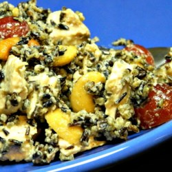 Classic Minnesota Wild Rice Salad Recipe - Everyone will enjoy this salad featuring wild rice, cooked chicken, and crunchy cashews along with plump juicy red grapes. Besides wild rice, the real star of this salad is the dressing that uses curry powder to provide a delicious and unique flavor.