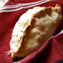 Coal Miners Pasties Recipe -  These are very old-fashioned pastry roll ups filled with a savory mix of meat, potatoes, turnips and onions. They 're baked, and served hot from the oven for supper or tucked into a picnic hamper and served at room temperature.