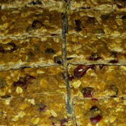 No-Bake Protein Bars Recipe - These protein bars  with chocolate, raisins, and cranberries never go into the oven. Just mix the ingredients and refrigerate until firm.