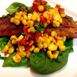 Grilled Salmon with Bacon and Corn Relish Recipe and Video - Try a new summery take on grilled salmon served with a warm bacon and sweet corn relish.
