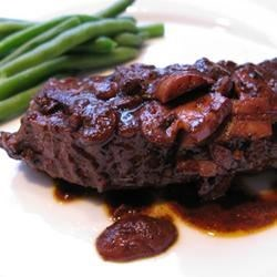 Easy Flat Iron Steak in Wine Sauce Recipe - Beef flat iron steaks get a spicy rub and a quick sear, and are served with a hearty red-wine and mushroom sauce.