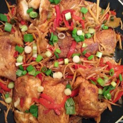 Cambodian Ginger Catfish Recipe - You'll love this kicky Cambodian catfish dish with onion, bell pepper, and fresh ginger at first bite.