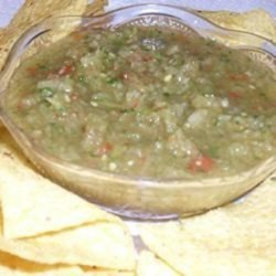 Spicy Green Tomato Salsa Recipe - Transform your green tomatoes into a spicy green tomato salsa with plenty of kick from jalapeno and serrano chile peppers.