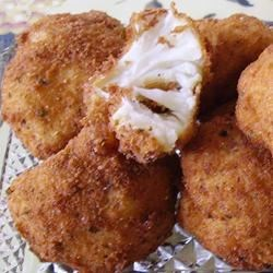 Fried Cauliflower Recipe - Tender bits of cauliflower are battered and deep-fried. Great for appetizers.