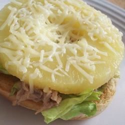 Hawaiian Tuna Sandwich Recipe - Here's a tropical twist on the tuna melt. Tuna is mixed with lemon juice and spices, then heated on a burger bun with mozzarella cheese and sweet pineapple rings.