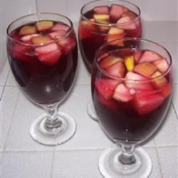 Sangria ala Felicia Recipe - This fruity wine and rum cocktail is sweetened with simple syrup and orange juice.