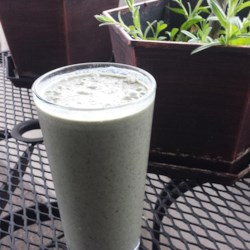 Kale and Berries Breakfast Smoothie Recipe - This green breakfast smoothie is an easy way to get a couple servings of fruit and veggies. With kale, berries, and a banana, it'll keep you full all morning.