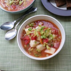 Irish Bacon And Cabbage Soup Recipe - This is a wonderfully simple chunky soup. I use good quality Irish back bacon but if you can't get this, it tastes equally good made with pancetta. The dark green colour of the cabbage alongside the tomatoes gives the soup a beautiful colour.