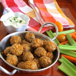 Spicy Buffalo-Style Meatballs Recipe - A spicy sauce familiar to fans of Buffalo-style chicken wings is used to bring heat to homemade meatballs in this recipe.