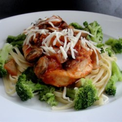 Chicken Parmesan with Linguine and Broccoli Recipe - Coated with grated Parmesan topping then browned, chicken breasts are simmered in tomato sauce with mushrooms, topped with mozzarella cheese, and served with linguine and broccoli--a complete dinner in 38 minutes!