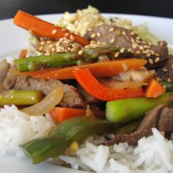 Essanaye's Sesame Beef Stir Fry Recipe - This sweet and savory beef stir-fry has plenty of colorful vegetables, including asparagus, mushrooms, and red bell peppers. All you need is a steaming bowl of rice to complete this meal.