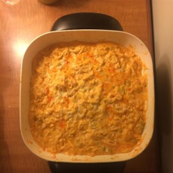 Cheesy Buffalo Chicken Dip Recipe - A tasty blend of ranch and blue cheese salad dressings gives this hot and cheesy chicken buffalo dip a flavorful twist.  Serve with scoop-style corn chips and celery sticks.