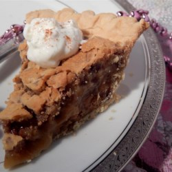 Peanut Butter Chip Pecan Pie Recipe - Peanut butter chips and pecans baked in a simple and delicious pie.