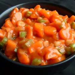 Marinated Carrot Salad Recipe - Tender coins of cooked carrots are tossed with crisp celery, green onions and bell pepper and marinated in a sweet and tangy tomato-based marinade.