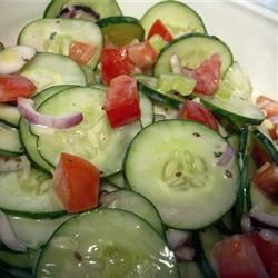 Dilled Cucumber, Tomato and Celery Salad Recipe - We developed this mid-summer salad to use an overabundance of fresh cucumbers, tomatoes, and celery. This recipe makes more dressing than you need for the salad, but it will keep almost forever in the refrigerator.
