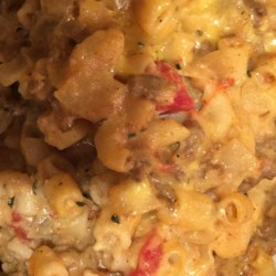 Cheesy Macaroni and Beef Casserole with Thyme Recipe - Cheese, onions, ground beef, and macaroni baked with cherry tomatoes and fresh thyme.  Simple and delicious.