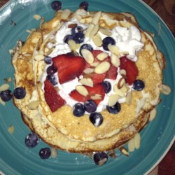 Gluten Free Protein Pancakes Recipe - Gluten-free protein pancakes made with cottage cheese, egg whites, and oats are a quick and easy breakfast. Serve with berries!