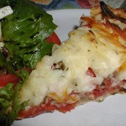 Tomato Pie II Recipe - Delicious and easy meal of tomatoes, cheese and seasonings baked in a pastry shell.