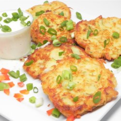 Irish Zucchini and Potato Pancakes Recipe - A favorite dish to eat during Lent, these Irish zucchini and potato pancakes are delicious with sour cream, applesauce, or even ranch dressing.