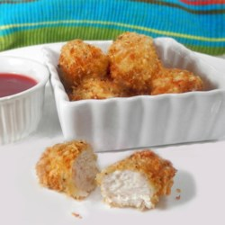 Baked Chicken Nuggets Recipe - A Parmesan crust lifts these chicken nibbles above the ordinary. Serve alone or with an array of dipping sauces.