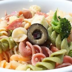 The Ultimate Pasta Salad Recipe - The tri-colored pasta along with the variety of vegetables, pepperoni, cheeses and spices is what makes this pasta salad out of this world. Great to take to a BBQ on those warm summer nights. This salad tastes wonderful right after you make it, but is best served the day after.