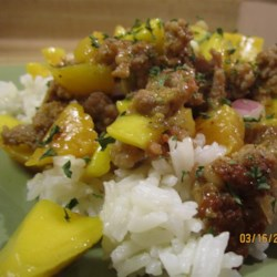 Sausage with Mango Salsa Recipe - Cilantro-lime rice is topped with a refreshing mango salsa and pan-fried turkey sausage for a zesty and colorful meal.