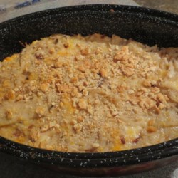 Even Better Cheesy Potatoes Recipe - Cheesy hash brown casserole is elevated to a new level when sauteed onions and garlic are added to the mix.