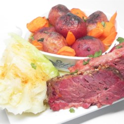 Spicy and Tender Corned Beef Recipe - Whether you're Irish or just Irish for a day, you and your family will enjoy this recipe for tasty beer-braised corned beef with potatoes and cabbage.