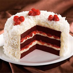 Cherry Red Velvet Cake Recipe - This is a moist, fruity Red Velvet cake that's pure heaven. Cherries and buttermilk are the secret add-in, and the homemade icing is a special treat. For a frosting shortcut, you can always use Duncan Hines Cream Cheese Frosting.