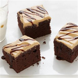 Peanut Butter Brownie Squares Recipe - Create a decadent peanut butter frosting, then drizzle our Duncan Hines Chocolate Decadence Brownies with a warm milk chocolate sauce. These Peanut Butter Brownie Squares are a winning combination.