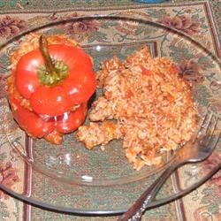 Sausage and Rice Stuffed Peppers Recipe - Stuffed green peppers with rice and sausage in cheesy tomato sauce. Tomato soup is used instead of tomato sauce.  Very, very good.