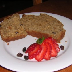 Apple Raisin Bread Recipe - Cinnamon and nutmeg spice up this loaf of apples, walnuts, raisins and oats.