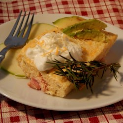 Holiday Rosemary and Ham Casserole Recipe - Cheesy grits seasoned with rosemary are layered over ham and baked into a rich and creamy casserole perfect for holiday mornings.