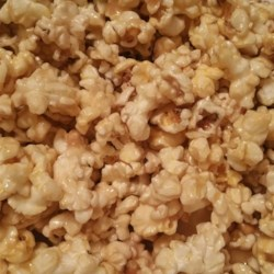 "Sticky Popcorn Recipe - Marshmallows, butter, and brown sugar are melted together and poured over popcorn creating a fun snack for the kids called ""sticky popcorn""."