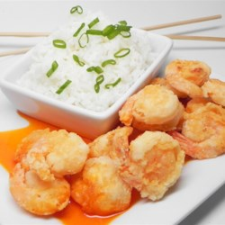 Easy Buffalo Shrimp Recipe - Shrimp are fried and then dipped in a buttery hot sauce in this quick and easy recipe for buffalo shrimp that are perfect for parties.