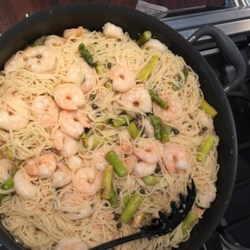 Diablo Shrimp Recipe - Shrimp cooked in jalapeno pepper-infused butter and olive oil bring the heat to this angel-hair pasta dish.
