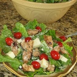 Teriyaki Chicken Salad Recipe - Chicken breasts marinate overnight in orange juice, soy sauce, and lemon/lime carbonated soda. These are then grilled, cut into strips and mixed with lettuce, tomatoes, and mozzarella, and a tasty garlic infused lemon and oil dressing.