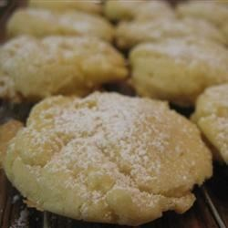 Orange Meltaway Cookies Recipe - Tender orange cookies are dusted with confectioners' sugar in this old family favorite recipe.