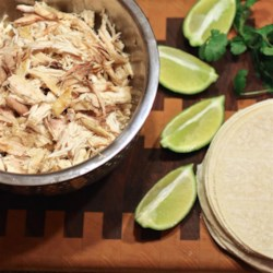 Slow Cooker Cilantro-Lime Chicken Tacos Recipe - Cook a whole chicken rubbed with garlic and lime juice in a slow cooker to get easily shredded meat to put on tortillas for a tasty chicken taco (Tuesday?) night.