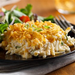 Cheesy Potato Casserole from Ore-Ida(R) Recipe - Comfort food at its best, this creamy, cheesy casserole with lots of shredded hash browns works either as a main dish or hearty side.