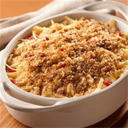 Country Style Hash Brown Casserole Recipe - Shredded hash brown potatoes in a creamy base with pepper Jack cheese and roasted red peppers make a delicious dinner casserole that will feed a crowd.