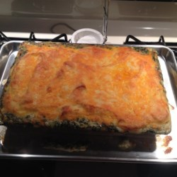 Fisherman's Pie Recipe - This cheesy casserole has moist chunks of fish in a rich white sauce and is a great way to use up leftover mashed potatoes.