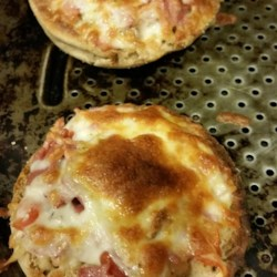 Quick and Easy Mini Salsa Pizzas Recipe - Top English muffin halves with salsa, bacon, and cheese and heat under the broiler for a small, tasty pizza treat.